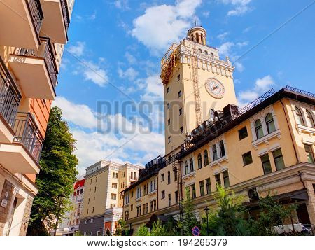 SOCHI, RUSSIA, SEP, 10, 2015: View on Rosa Khutor colorful modern buildings clock tower. Olympic village Sochi 2014. Best famous Sochi holidays vacation bike ski tours. Sochi modern architecture