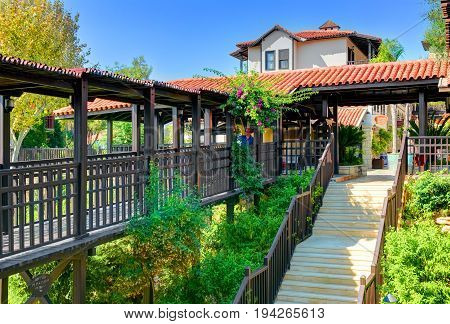 BELEK, TURKEY, SEP. 10, 2010: Summer view on hotel Paloma Grida Village Spa. Italian style wood architecture. Wooden stairs staircase stairway. Turkey holidays vacations famous tours. Luxury hotels