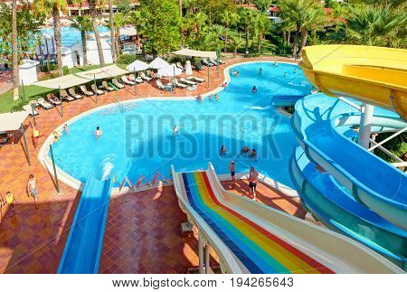 BELEK, TURKEY, SEP. 10, 2010: Summer water slides swimming pools of hotel Paloma Grida Village. Aqua park color water slides for children joy and parents. Turkey holidays vacations famous tours