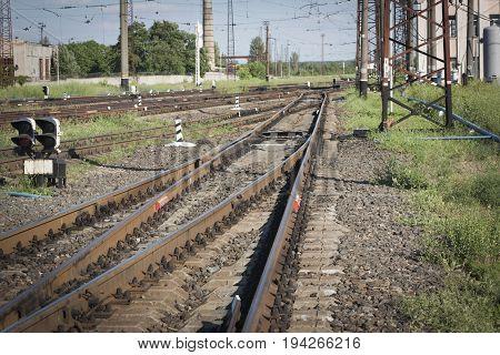 Railway Tracks at a Major Train Station at Sunset