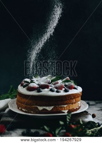High angle view of strawberry cake on a wooden table