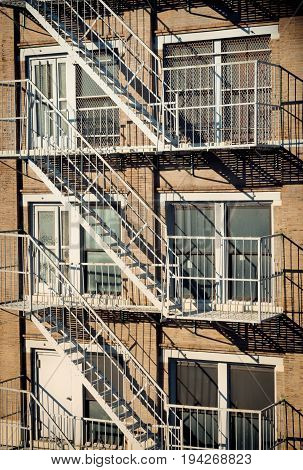 Exterior Of A Building With Old Fire Escape In  New York City