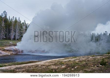 Riverside Geyser Eruption  In Yellowstone National Park, Usa