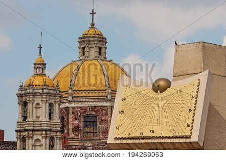 Old Basilica Of Our Lady Of Guadalupe And Clock In Mexico City