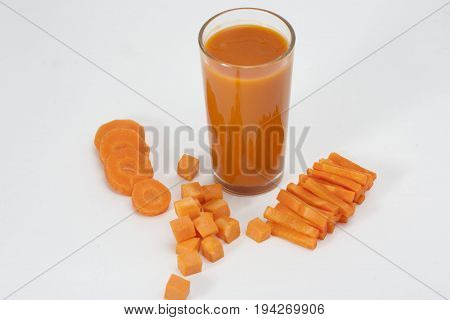 drink. Carrot juice and slices of fresh carrot on white background