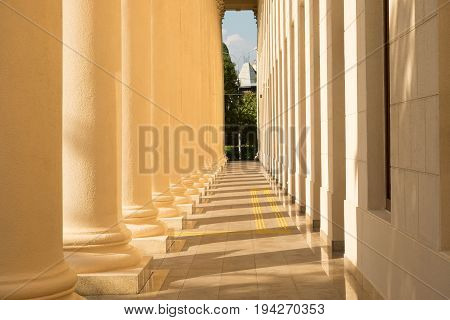 Row of column in colonnade creates a classical entrance to the Winter Theater in Sochi City.