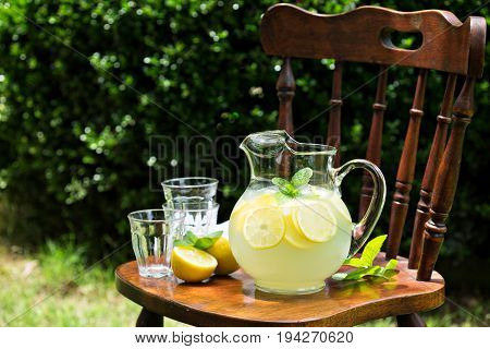 Traditional cold refreshing lemonade in a pitcher