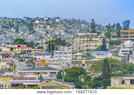Elegant neighborhood and favela hill view of Guayaquil city Ecuador