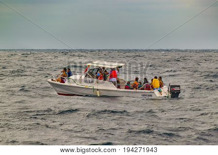 SALINAS, ECUADOR, JULY - 2016 - Small passenger touristic boat with people in a trip to see whales in Salinas Ecuador