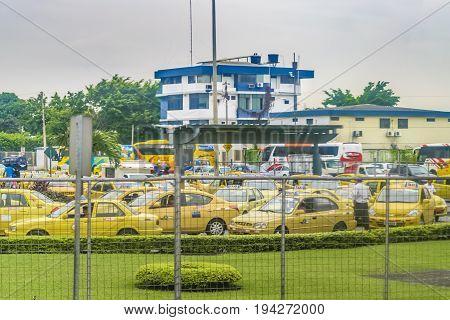 GUAYAQUIL, ECUADOR, JULY - 2016 - Congested traffic at bus terminal in Guayaquil Ecuador
