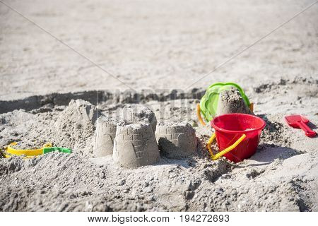 Children's Fun On The Beach, Toys And Built Castles, Summer Rest