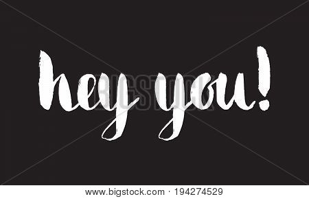 Grunge handwritten calligraphic ink inscription Hey you on black background. Hand write lettering for banner, poster, postcard, t-shirt, greeting card, invitation. Vector illustration.