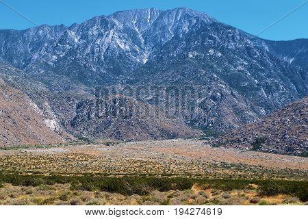 Desolate desert landscape with Mt San Jacinto beyond taken near Palm Springs, CA