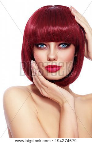 Beautiful fashion redhead girl with bob haircut and stylish make-up over white background, copy space