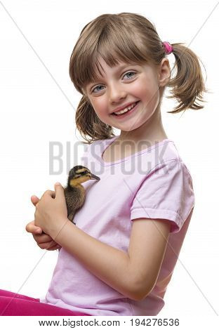 a little girl holding one little duckling