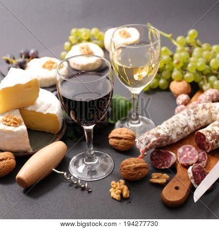 wine glasses with cheese and salami