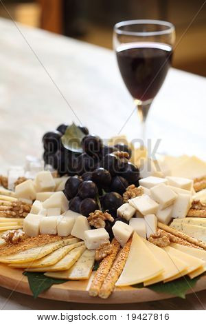cheese plate with grape and red wine