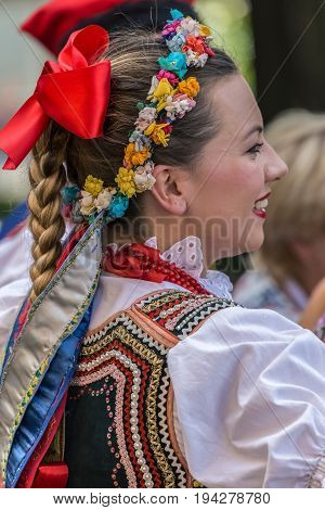 TIMISOARA ROMANIA - JULY 6 2017: Young dancer girl from Poland in traditional costume present at the international folk festival