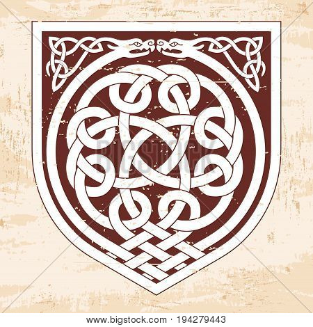 Celtic national ornament interlaced tape. Brown pattern with the aging effect on a beige background.