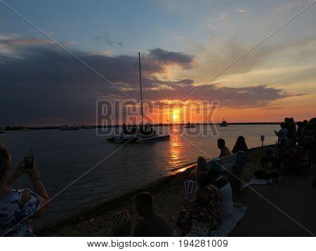 Beautiful Summer Sunset with boats at City Beach in New Buffalo, Michigan