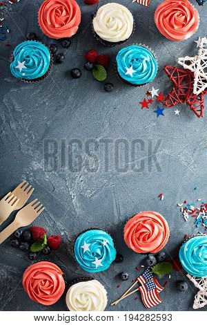 Red, blue and white cupcakes for the Fourth of July overhead shot with copy space
