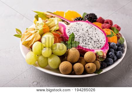 Exotic tropical fruits with dragon fruit, longan, maracuya on a plate