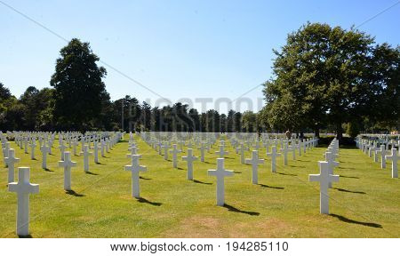 COLLEVILLE-SUR-MER FRANCE - AUG 12: Tombstones at the Normandy American Cemetery and Memorial in Colleville-Sur-Mer France are shown on August 12 2016.