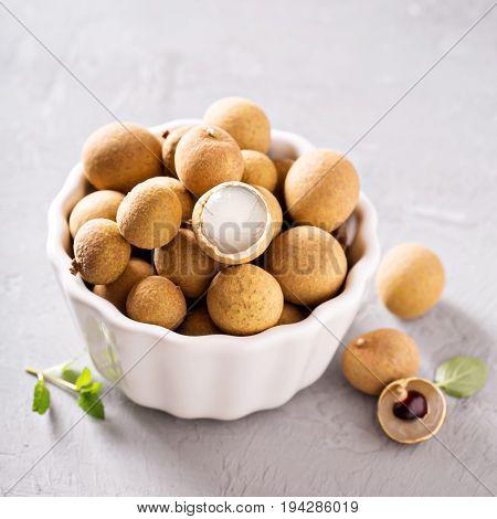 Longan fresh exotic tropical fruit in white bowl