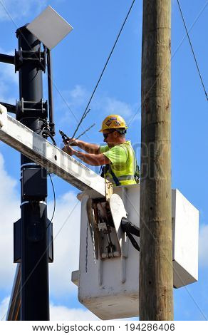COLUMBUS OH - JUNE 27: An electrician works on an electrical pole near the Convention Center on June 27 2017.