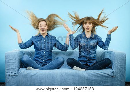 Two Happy Shocked Women With Windblown Hair
