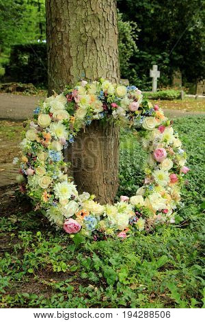 Sympathy wreath in pastel colors made of various flowers