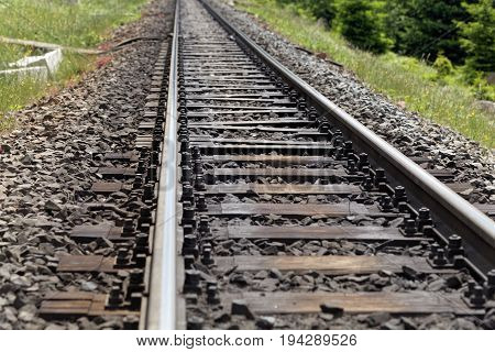A line of rails with wooden railroad ties.