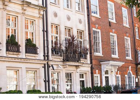 London, UK - September 8, 2016: Windows of the luxury apartments in Mayfair. Centre London residential buildings.  Kensington church street.
