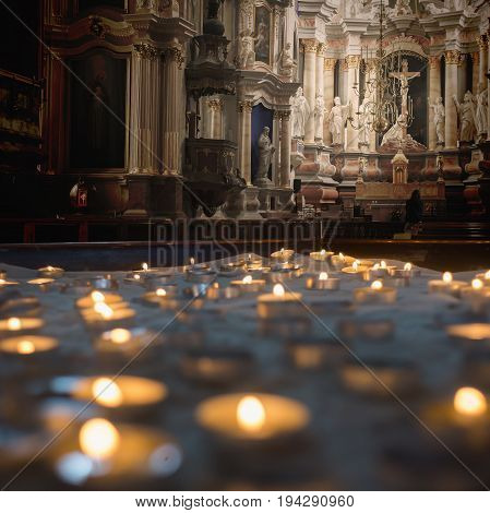 Kaunas Cathedral Basilica is a Roman Catholic cathedral basilica in Kaunas Lithuania.The main altar view.Many small votive candles on a sand in a special holder box