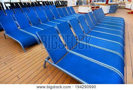 Blue Deck Chairs neatly placed on a Ship Deck
