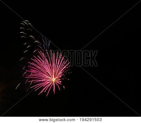 Colorful fireworks light up the night time sky in summer