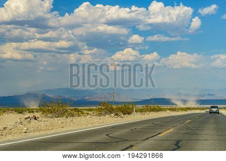 Desert highway to Death Valley National Park birth of a tornado California