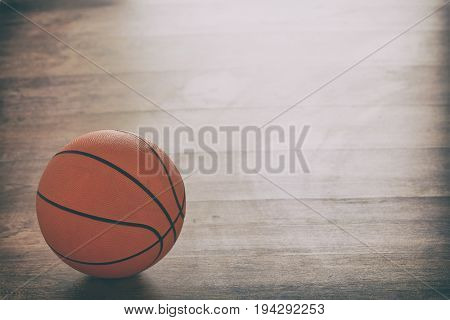Basketball on a wooden court floor