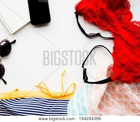 Top view travel set sunglasses phone book swimwear Underwear hat copy space.