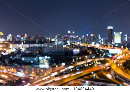 Night aerial view city and highway blurred bokeh light abstract background