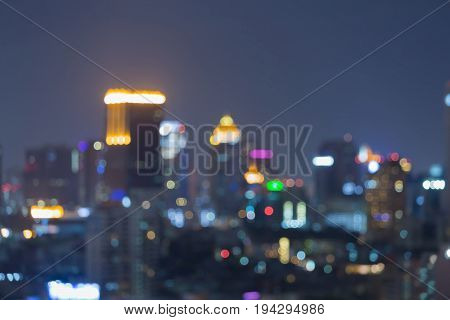 Night blurred bokeh central business downtown cityscape abstract background