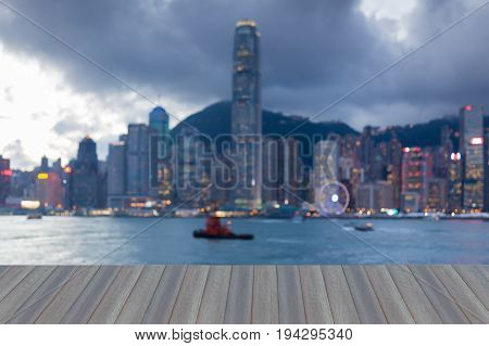 Opening wooden floor City of Hong Kong blurred bokeh light seafront abstract background