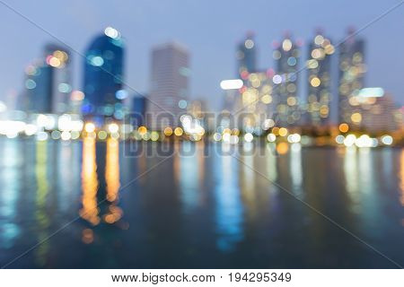 Blue twilight city office building blurred bokeh light abstract background