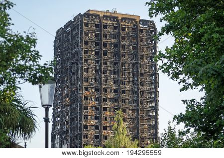 LONDON, UK - JULY 5, 2017:  Charred remains of the Grenfell Tower block of council flats in which at least 80 people are feared to have died in a fire Kensington West London.