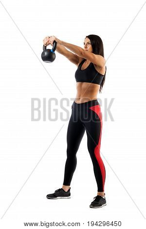 Slender brunette woman doing exhalation with weight on biceps on white isolated background front view arms raised high