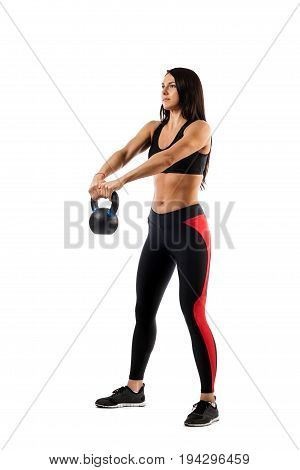 Slender brunette woman doing exhalation with weight on biceps on white isolated background front view hands in front of her