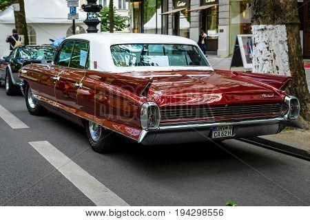 BERLIN - JUNE 17 2017: Full-size luxury car Cadillac Fleetwood 1962. Rear view. Classic Days Berlin 2017.