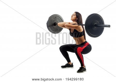 Young athletic brunette woman doing squat with a barbell loki in front of him position full sucker on white isolated background