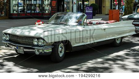 BERLIN - JUNE 17 2017: Full-size luxury car Cadillac Series 62 Convertible Coupe 1961. Classic Days Berlin 2017.