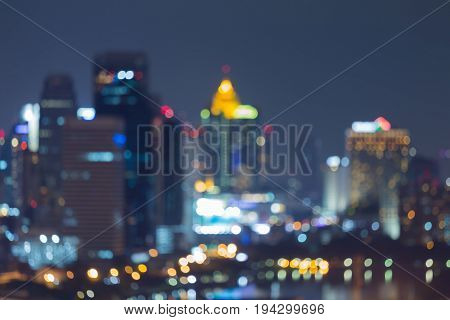 Night city blurred bokeh light central business downtown abstract background
